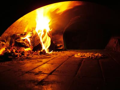 Pizza in woodburning oven.