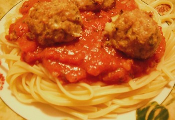 Baked Ground Chicken Meatballs with tomato sauce and spaghetti.